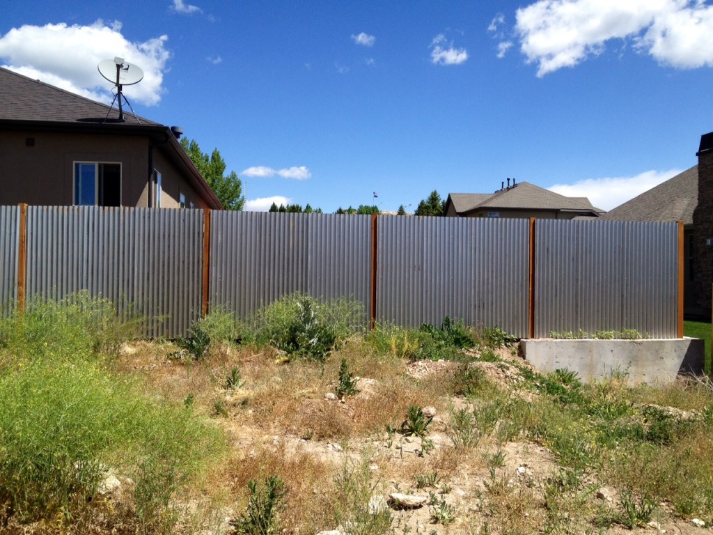 corrugated metal privacy fence image — good christian